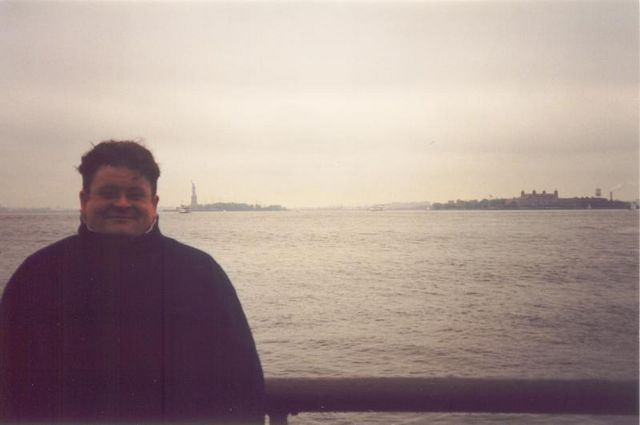 Keith with Ellis Island in the background
